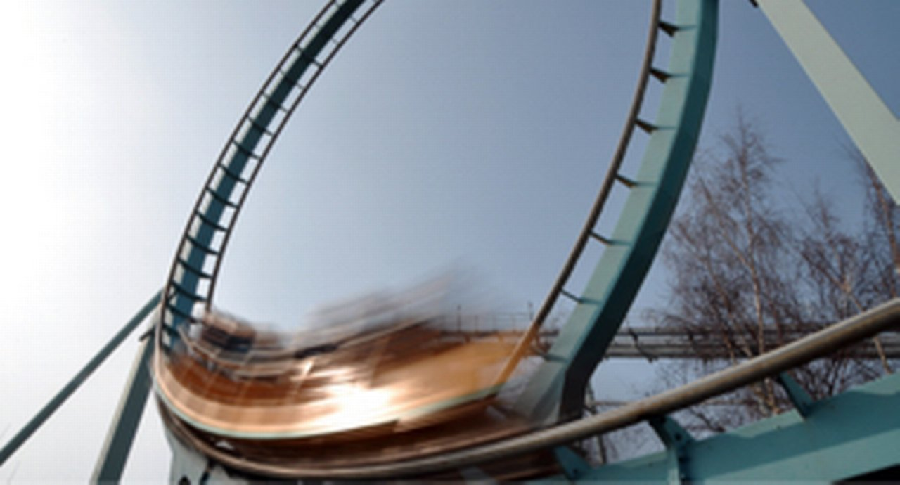 A roller coaster in full motion climbing a loop