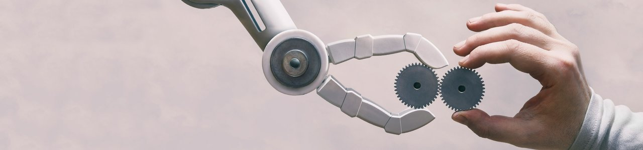 A robot arm and a human hand holding cogs towards each other