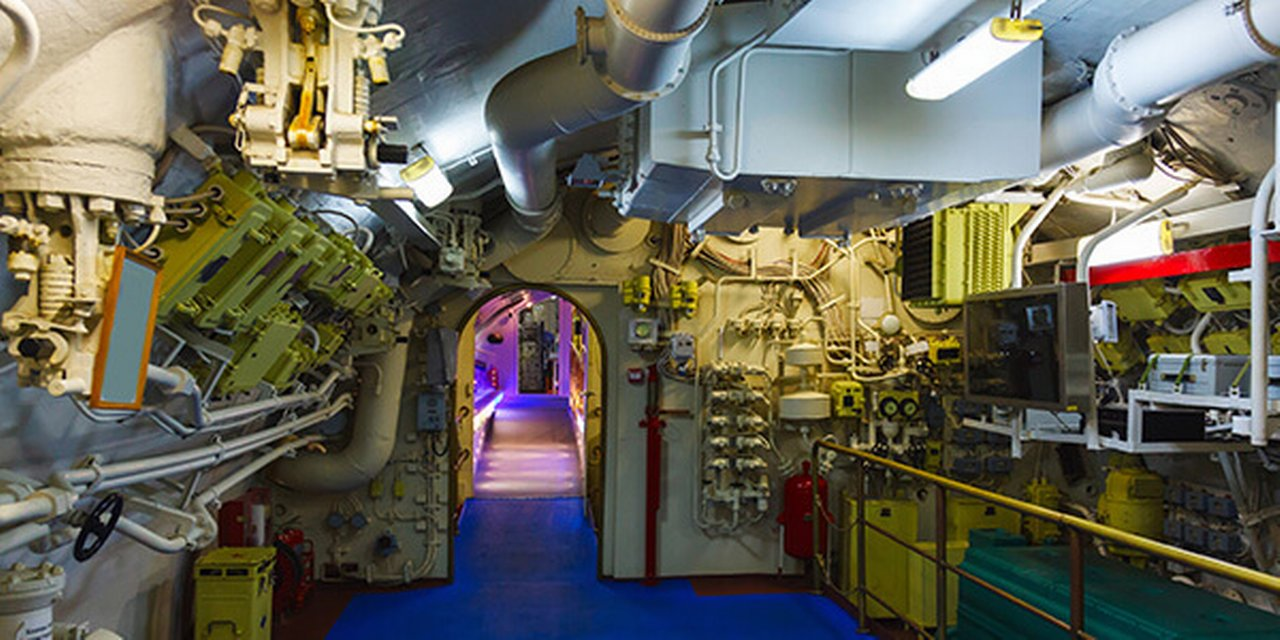 A modern complex ship's engine room indirectly illuminated
