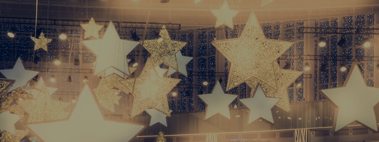 Golden Stars warmly illuminated hanging from the ceiling